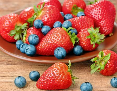 a place of strawberries and blueberries