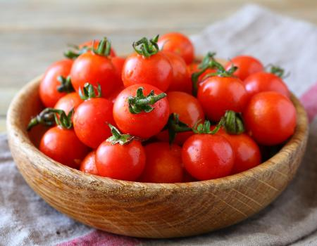 cherry tomatoes in wooden bowl